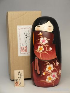 This is a Japanese Sosaku Kokeshi Doll desing by Nozawa Kaoru.  The tittle is Nadeshiko,meaning Japanese lovely women or girls.