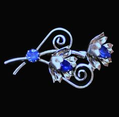 Vintage Blue Sapphire Rhinestone Flower Brooch Pin In Silver Tone, Gift For Her. This brooch is beautiful. High quality polished silver tone metal. Rhinestones are a striking blue. 2 marquis cut rhinestones, and one round. This pin wood look lo...