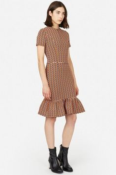 This dress is giving us Goth Taylor Swift vibes, and we surprisingly don't hate it.Opening Ceremony Lotus Check Dropped Ruffle Zip Dress, $425 $128, available at Opening Ceremony. #refinery29 http://www.refinery29.com/business-casual-for-women#slide-5