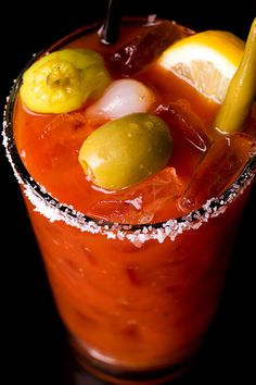 bloody mary--ill take mine with extra olives, dill pickle, lime, hot sauce!!  and regular tomato juice