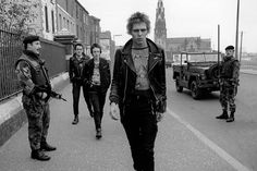 """Strummer was a big fan of Northern Irish punk, once writing an article on the subject, stating:""""When punk rock ruled over Ulster, nobody ever had more excitement and fun. Between the bombings and shootings, the religious hatred and the settling of old scores, punk gave everybody a chance to live for one glorious burning moment."""""""