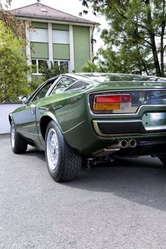 Maserati Khamsin. Love the floating taillights in glass feature.