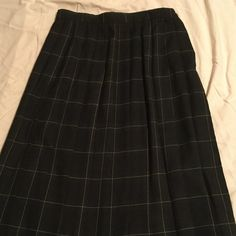 Classic plaid skirt Classic plaid, pleated skirt. Green, navy, yellow plaid. Ideal for the office. Side zip; side elastic for a perfect fit. Polyester. Must be dry cleaned. 32 1/2 inches from waist. * Made in USA* Requirements Skirts Midi