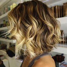 Beach waves and highlights. I LOVE her hair color and cut! I could do this easily if I grew out my hair...