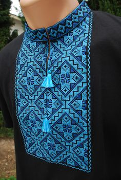 Stylish and contemporary shirt with real cross-stitch embroidery.