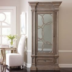 I love the classic details in the moldings and shape, but the whimsy of the bubbles on the mirrored glass are just the perfect mix! I pinned this Mirrored Display Cabinet from the Habersham event at Joss & Main!