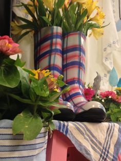 April showers party - boots as vases: just put old glass jars inside the rainboots, fill with water and add flowers