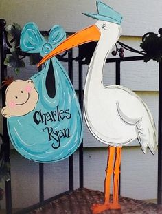 This adorable stork and baby ring is made if laser wood and painted with high quality non toxic acrylics. It has a shimmer sealer for outdoor protection. It can be painted for either a girl or boy and the bundle can be any color, just indicate name a Baby Stork, Stork Baby Showers, Baby Shower Niño, Baby Shower Parties, Baby Shower Themes, Baby Boy Decorations, Baby Decor, Baby Door Signs, Baby Motiv