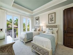 Coastal bunk room with twin beds and blue ceiling.  Ft Charles Dr in Port Royal | Naples, Florida