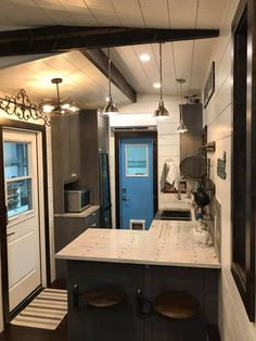 "The Empty Nester: a beautiful, rustic tiny home and winner of ""Best in Show"" at the 2017 Colorado Tiny House Festival."