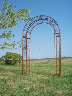 """Wrought Iron Round Top Arbor - Garden Arch Yard Art   eBay  This Arbor is 100"""" before staking 92""""after. Measures 60"""" from outside to outside and 45"""" inside by 12"""" deep.    We can ship this item in a Rusty Finish or put a Clear Coat Finish on the Rust. Also we paint it for you so look at the picture of baskets to see our other colors."""