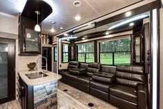 Relax and enjoy all of Road Warrior's RT package #luxury features including the reclining couch with massage and fold-down backs; complete with cup holders, USB and 110 volt outlets. Pictured #HeartlandRVs #RoadWarrior 413: http://www.heartlandrvs.com/brands/luxuryth/road-warrior/rw-413