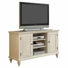 """Wood media console with louvered doors and hidden cable access points.   Product: Media console   Construction Material: Wood and engineered wood     Color: Brushed white     Features: Shutter doors and turned feetTwo storage cabinets with two adjustable shelves eachHidden cable access points for neat wire management    Dimensions: 32"""" H x 56"""" W x 18"""" D"""