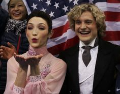 "Charlie White and Meryl Davis of the United States react in the ""kiss and cry"" area during the Team Ice Dance Short Dance at the Sochi 2014 ..."