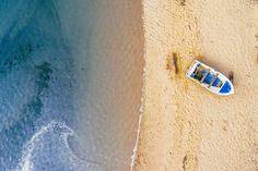 A boat on a beach.