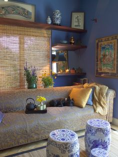 """love the idea of no cushions to move around!! this asian inspired room looks so restful and eclecti"""