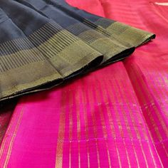 Elegant and ever graceful Black Kanchivaram Silk Saree with Pink Pallu. Wear it to any party or event and make sure to get accolaes of compliments.