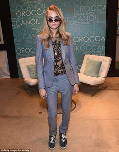 Smart look: Earlier in the day, Cara wore a suit while attending a Variety sponsored event...