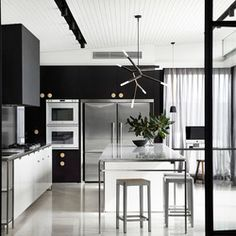 A modern makeover by rosstang architects with a striking monochrome color scheme throughout.