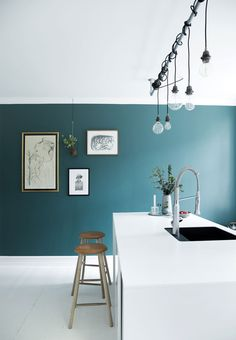 White kitchen with blue wall