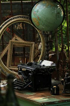 Travel theme rental includes vintage globe, typewriter, cameras, letters, and frames