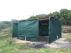 Horse shelter, tanking upright poles, corrugated iron roof and shade cloth walls.