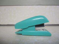 Turquoise stapler.