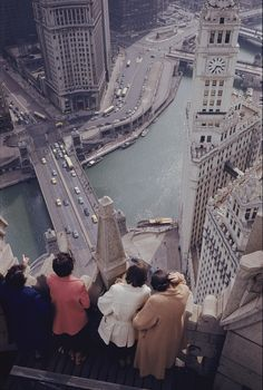 Tourists atop the Chicago Tribune building look down on the Chicago River, the site of Old Fort Dearborn.