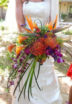 Leucospermum (pincushion) flowers with bird of paradise, trailing Typha leaves, orchids #wedding #bouquet