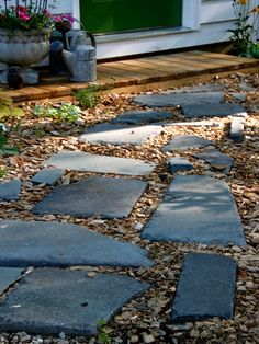 Use a few leftover bluestones from a backyard patio project to help form a path to your coop door.