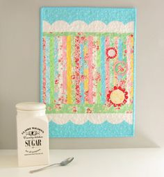 I love the stripes of this little doll quilt. And of course the scalloped border!