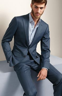 Ermenegildo Zegna. Subtle yet refreshing. A unique color for a man\'s suit that still looks professional enough to wear to the office for the modern man.