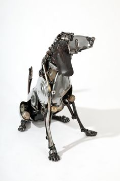 """Sitting Hound"" - sculpture made of car parts by James Corbett; 28"" H x 18"" W x 32"" L"