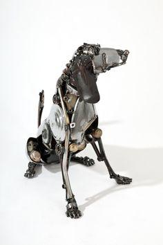 """Sitting Hound"" - sculpture made of car parts by James Corbett;  28"" H x 18"" W x 32"" L"