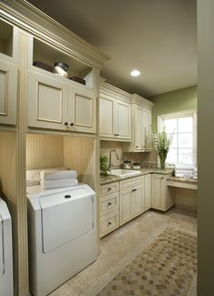 love the lighting by each appliance so you can see better - Organized Laundry Room = Happy Wife