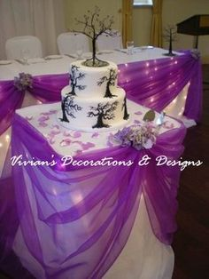 Love just the purple draping and purple rose petals on the table :) <3