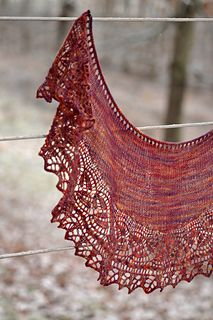 Cables, dayflower lace, and a leafy edging adorn the edge of this crescent-shaped shawlette, perfect for that special small skein. The narrow lace border is worked long-ways, using a method of keeping live stitches on the needle that eliminates the need to pick up stitches for the body of the shawl.