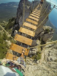 Don't look down. Crossing rope bridges on Aypetry mountain in the Ukraine. Photo by Dmitry Sivolap. Capture this hands-free perspective using the Chesty: http://gopro.com/camera-mounts/chest-mount-harness