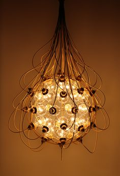 hanging lamp, with copper wires that snake around the outside of the glass orb, connecting to light bulbs within. Lamp Design, Lighting Design, Cool Lighting, Lamp Light, Light Bulb, Chandeliers, Orb Chandelier, Steampunk Lamp, Interior Design Tips