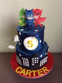 Child's birthday cake. PJ Mask, buttercream, with fondant city scape