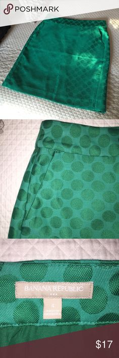 """Banana republic green pencil skirt Beautiful emerald green pencil skirt with subtle polka dot detail! Fully lined with pockets! Back zipper and safety clasp closure. 30"""" high waist, 36"""" hips, 20.5"""" overall length. Skirt is in perfect condition other than at the bottom in the back where the threads were removed. Please see last photo. Not that noticeable, but I want you to be aware. Size 4. Banana Republic Skirts Pencil"""