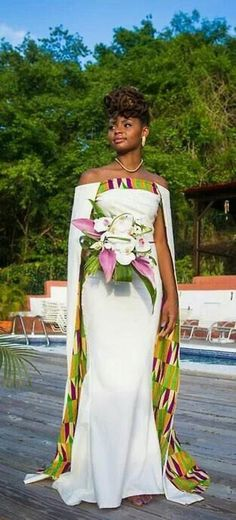 A beautiful off shoulder maxi dress with a floor length cape. It fastens at the back with a zipper. Fully lined and made from 100% African print cotton. Fabric model has on may not be available. Buyers will be asked to send me their body measurements as dress is customised for buyer in her exact