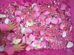 {Flowers and Fairies Sensory Tub} So pink!