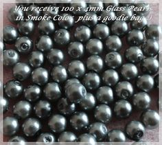 '100 Glass Pearls Plus a Goodie Bag' is going up for auction at 12pm Mon, Oct 29 with a starting bid of $5.