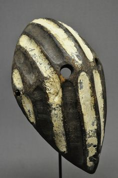 Congo. Wood Mask carved  with white pigment that has been painted in a bold striped design.