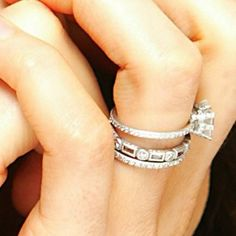 Kate Beckinsale's middle stacking ring. Love the simpleness of this but yet the 3 rings stacked together.