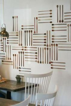 wood spoon wall decorations horizontal and vertical lines.