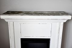 Electric fireplace makeover- giving your dinky electric fireplace some height!