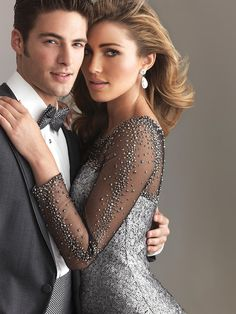 Short, cocktail gown in matte sequin. The sheer illusion neckline and sleeves are embellished with crystals. Night Moves 6603