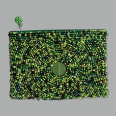 This stylish, hand-made coin purse from India harkens to the unique folk art style that House of Blues celebrates. Each coin purse is unique. $14